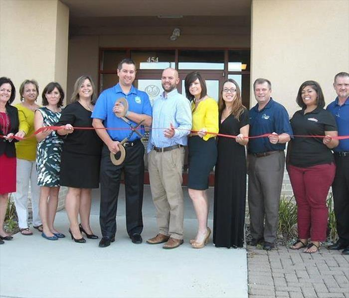 Marketing Reps. attending Ribbon Cutting for Local a Business