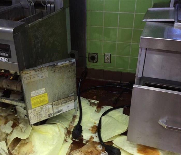 Grease everywhere after the fryer overflowed